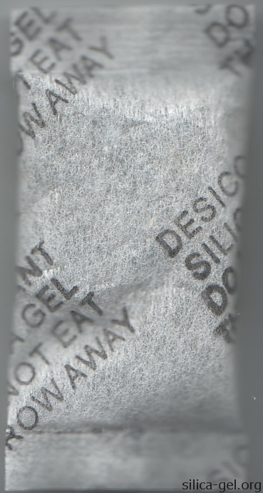 Narrow textured packet with black writing.