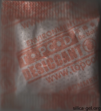 TOPCOD desiccant packet printed in orange.