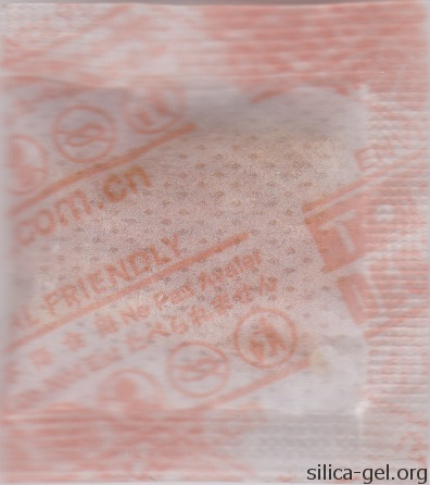 TOPCOD desiccant packet printed in orange. (rear image)
